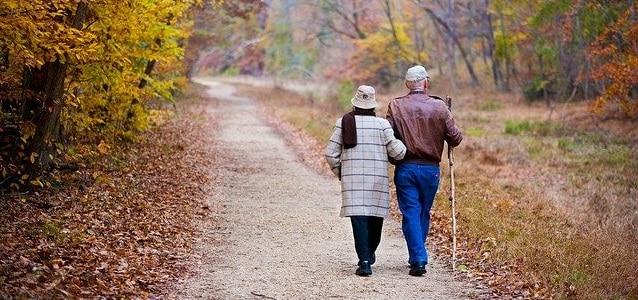 elderly couple walking social security
