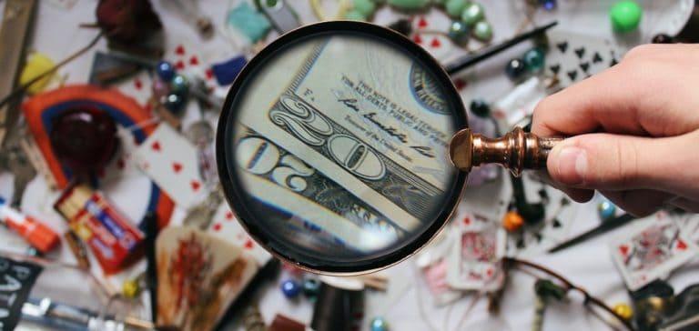 magnifying glass money debunking national debt