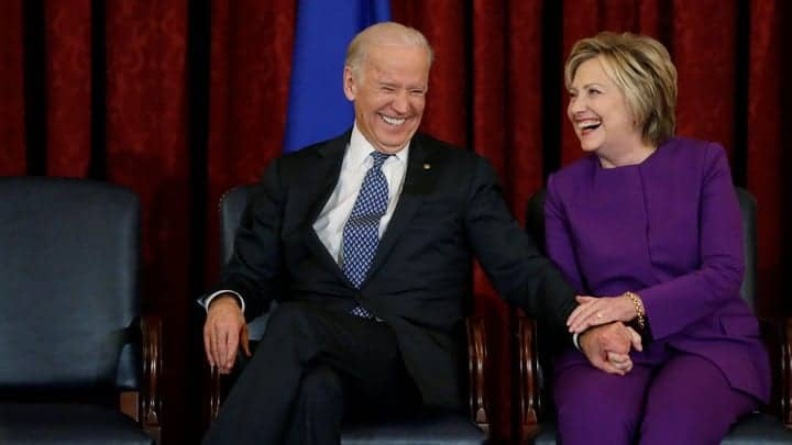 Biden and Clinton laughing together