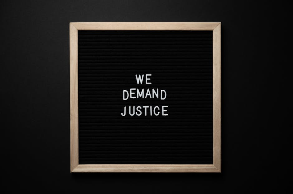 "Blackboard with ""We Want Justice"" on it"