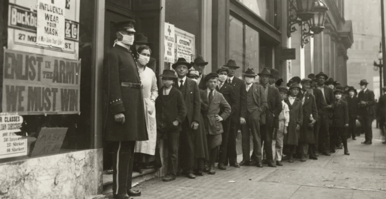 People wait in line to get flu masks to avoid the spread of Spanish influenza on Montgomery Street in San Francisco in 1918