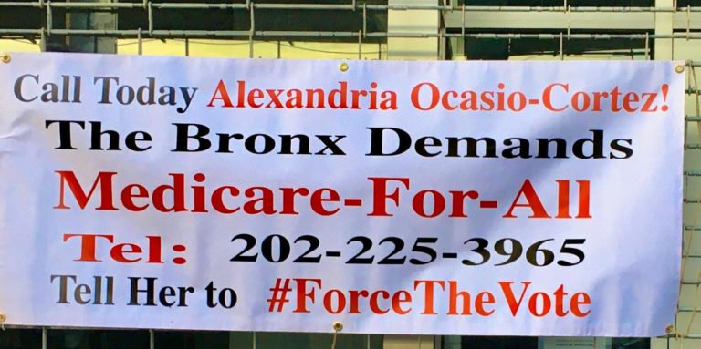 A sign asking AOC to #ForceTheVote