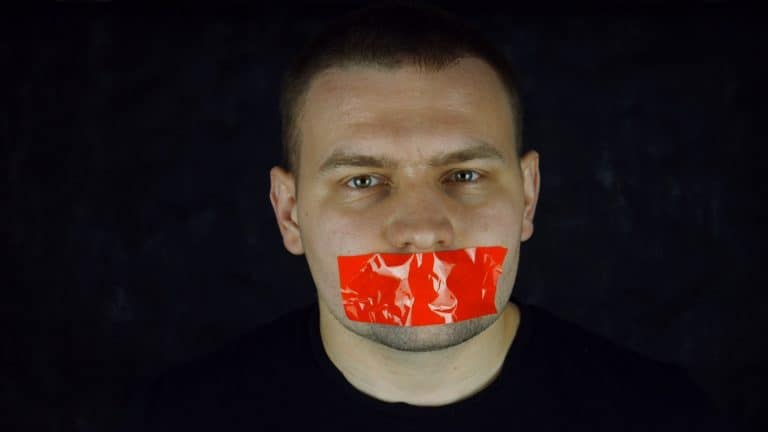 Man with tape across his mouth