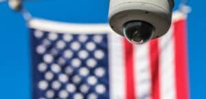American Flag with a security camera in front of it