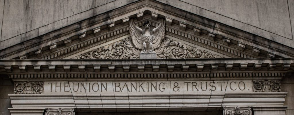 concrete facade of a bank and trust building
