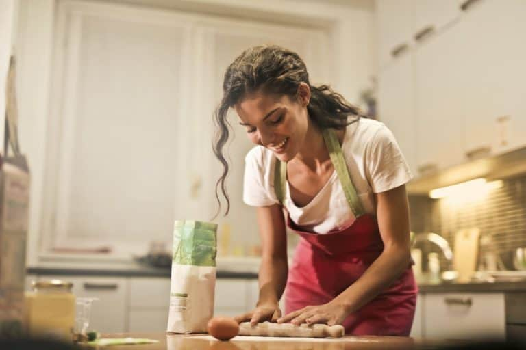 Housewife rolling dough