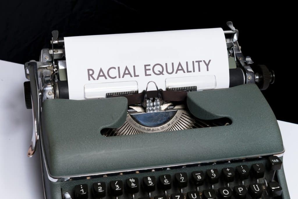 vintage typewriter, paper reads RACIAL EQUALITY