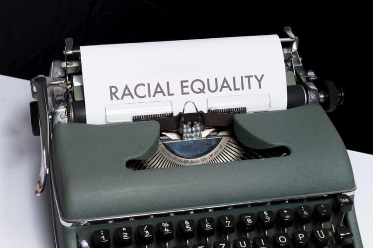 vintage typewriter, paper reads RACIAL EQUALITY