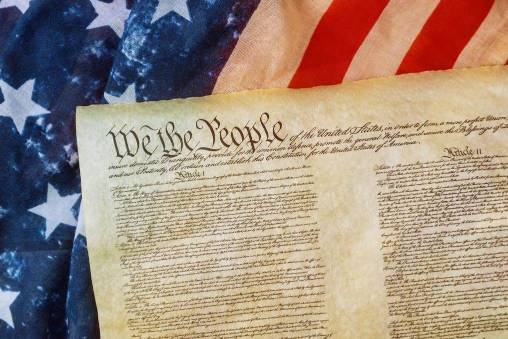 Closeup of a replica of U.S. Constitution document of grunge American flag on We the people Bill of Rights