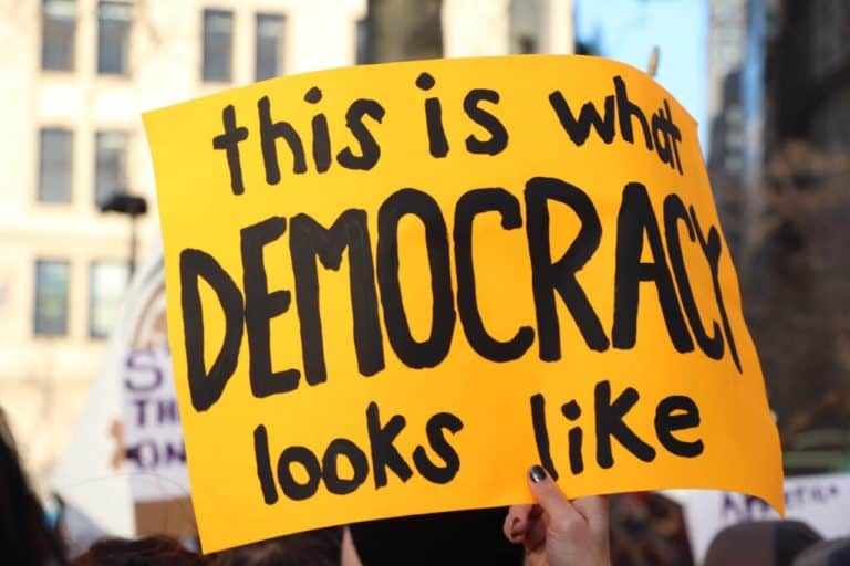 """Sign saying """"This is what democracy looks like"""""""