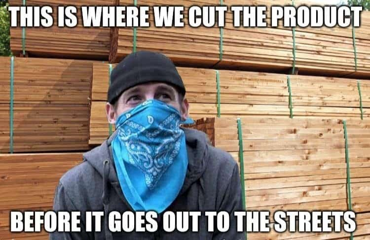 Man in front of lumber