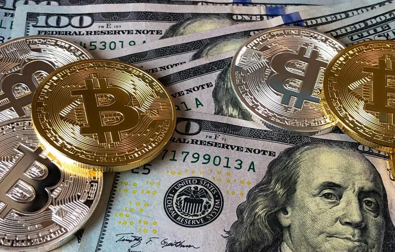 Bitcoins and U.s Dollar Bills