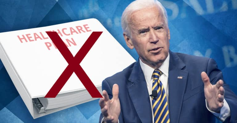 """President Biden with a book with """"Healthcare Plan"""" with a red X over it"""