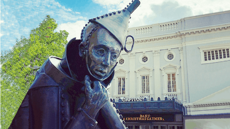Statue of the Tin Man in a Thinker pose